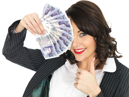 woman holding money: Attractive Young Woman Holding Money Stock Photo