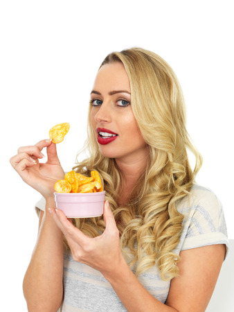 crisps: Attractive Young Woman Eating Potato Crisps