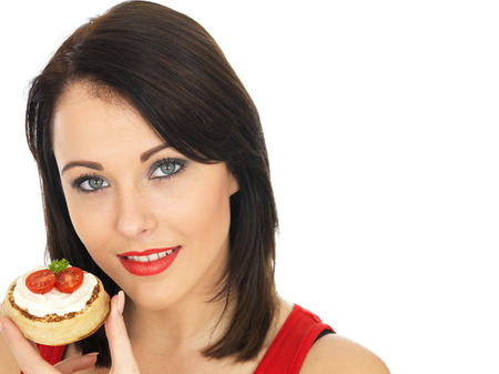 cream cheese: Attractive Woman Eating Toasted Crumpet with Cream Cheese and Tomato
