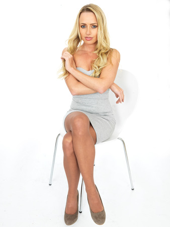 thoughful: Sexy Thoughful Young Woman Wearing a Mini Dress