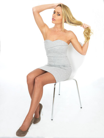 Sexy Young Business Woman Playing With Her Hair photo