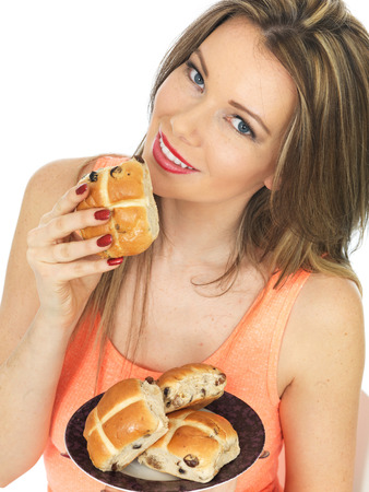 Attractive Woman With Easter Hot Cross Buns photo