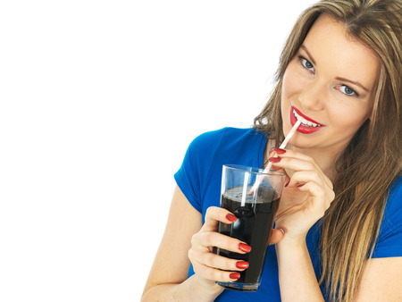 fizzy: Attractive Young Woman Drinking Fizzy Cola Drink