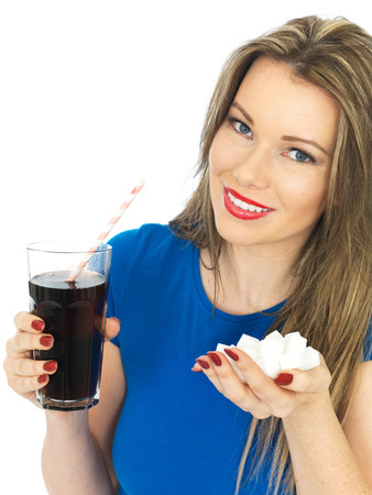 fizzy: Attractive Young Woman Drinking High Sugar Fizzy Drink
