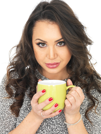 thirty something: Young Woman Holding a Mug of Tea Stock Photo