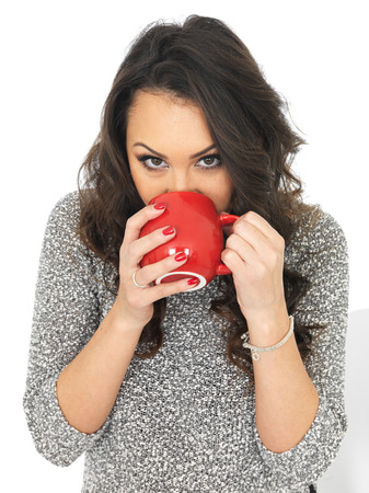 thirty something: Attractive Young Woman With a Mug of Coffee