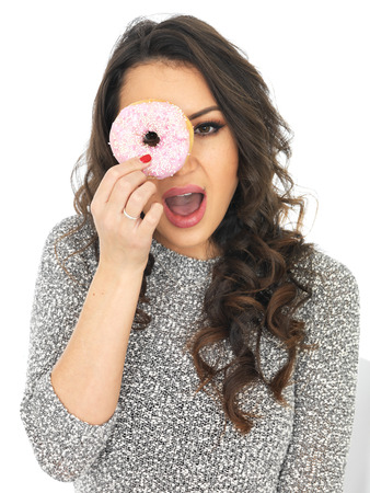 thirty something: Attractive Young Woman With Iced Donuts