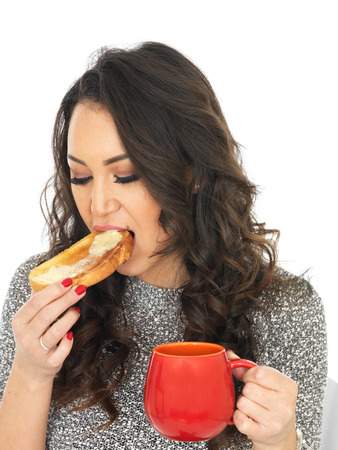 thirty something: Attractive Young Woman Eating Tea and Toast