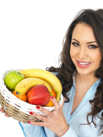 thirty something: Attractive Young Woman Holding a Bowl of Fruit Stock Photo