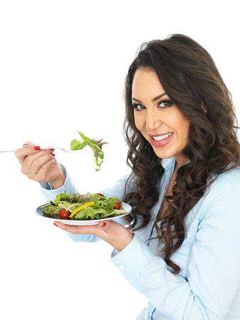 thirty something: Attractive Young Woman Eating a Salad Stock Photo
