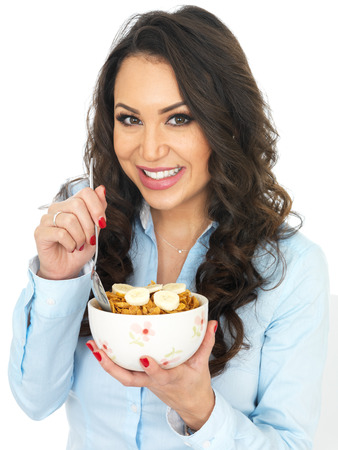 thirty something: Attractive Young Woman Eating Breakfast Cereals with Banana