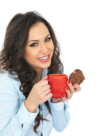 thirty something: Attractive Young Woman Enjoying Tea and Biscuits