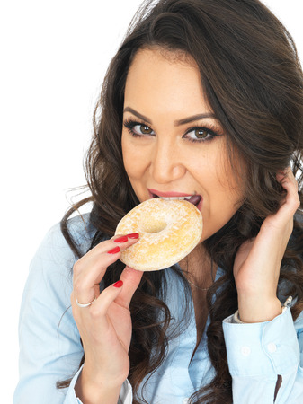 thirty something: Attractive Young Woman Enjoying a Sugar Coated Donut