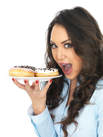 thirty something: Attractive Young Woman Tempted by Iced Donuts