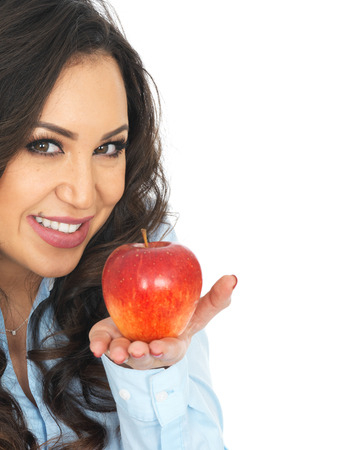 thirty something: Young Woman Holding a Red Apple