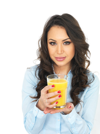thirty something: Attractive Young Woman Drinking Fresh Orange Juice