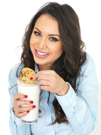 thirty something: Attractive Young Woman With a Glass of Milk and Biscuit
