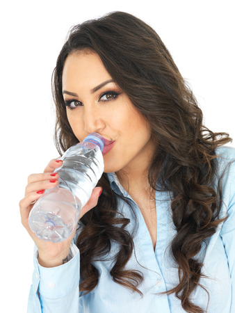 thirty something: Attractive Young Woman Holding a Bottle of Mineral Water Stock Photo