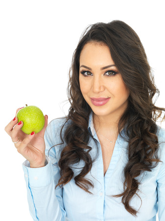 thirty something: Attractive Young Woman Holding a Green Apple