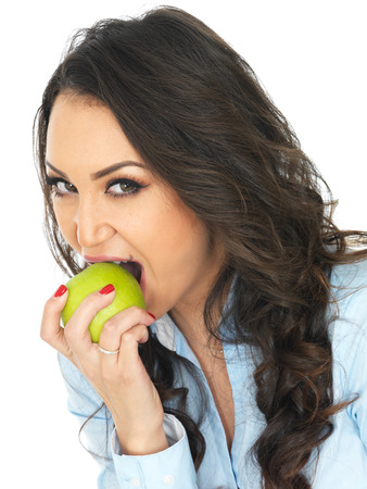 thirty something: Young Woman Eating a Green Apple