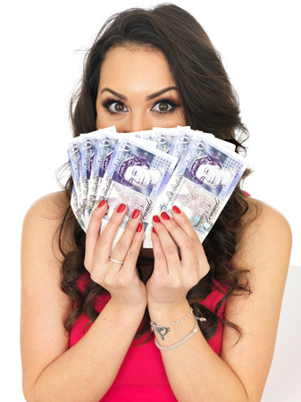 Happy Young Woman Holding a Fan of Money photo