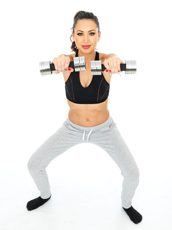thirty something: Attractive Young Fitness Model Exercising with Weights