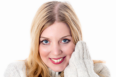 Model Released. Happy Young Woman Wearing a Woolen Jumper Stock Photo