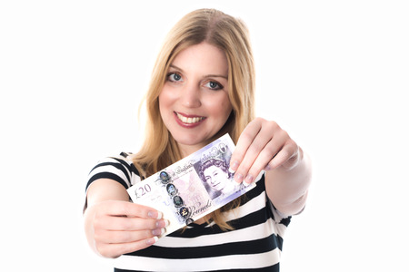 woman holding money: Model Released. Young Woman Holding Money