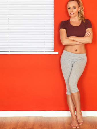 tied down: Attractive Young Woman Resting After Workout Stock Photo