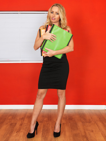 Attractive Young Woman Holding Business Files