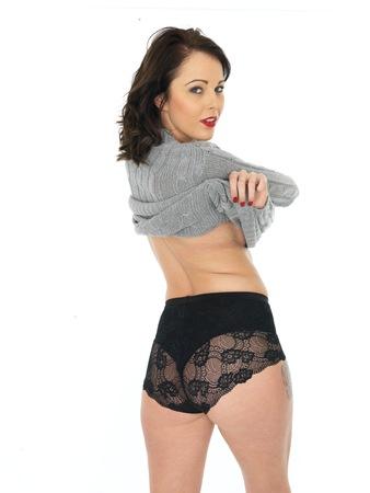 erotic fantasy: Sexy Young Pin Up Model Wearing a Grey Jumper