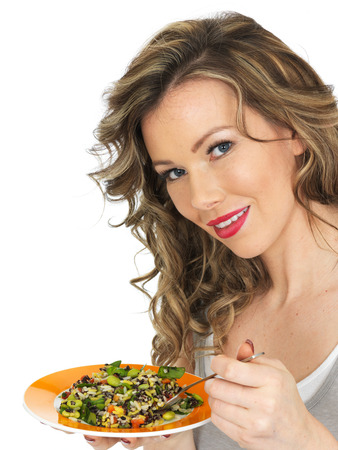 aromatic: Healthy Young Woman Eating an Aromatic Salad Stock Photo