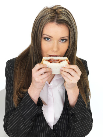 adult sandwich: Young Attractive Business Woman Eating a Bacon Sandwich