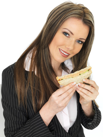 adult sandwich: Young Attractive Business Woman Eating a Brown Bread Sandwich