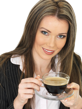 rushed: Young Happy Relaxed Business Woman Drinking a Cup of Black Coffee