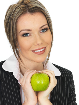 elevenses: Young Happy Business Woman Eating a Fresh Ripe Juicy Green Apple