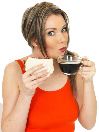 elevenses: Attractive Young Woman With a Black Coffee and Bacon Sandwich