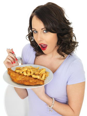 model fish: Young Attractive Woman Eating Traditional Fish and Chips