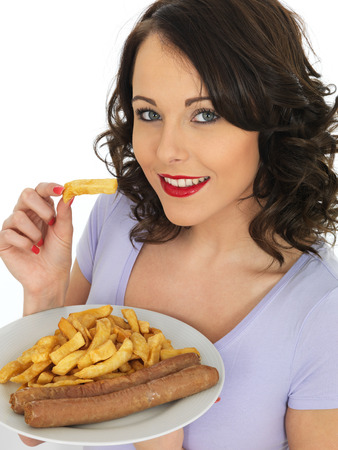 jumbo: Young Attractive Woman Eating Jumbo Sausages and Chips