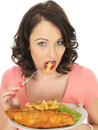 Young Attractive Woman Eating Fish and Chips with Mushy Peas Stock Photo