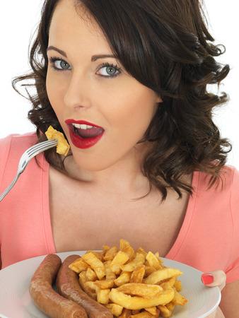 jumbo: Young Attractive Woman Eating Jumbo Sausage and Chips