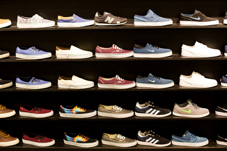 wall mounted: Selection of Wall Mounted Colourful Trainers in a Shop Display