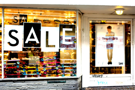 retail scene: Sports Shop Front Window Sale Sign Old Town Stavanger. Editorial
