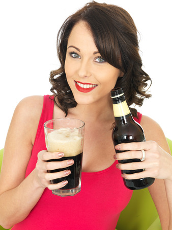 confortable: Attractive Relaxed Young Woman Drinking Beer Stock Photo