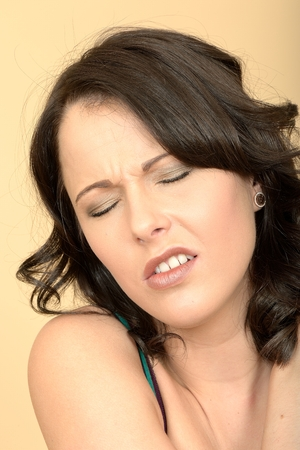 Close Up of an Attractive Young Woman Looking in Pain photo