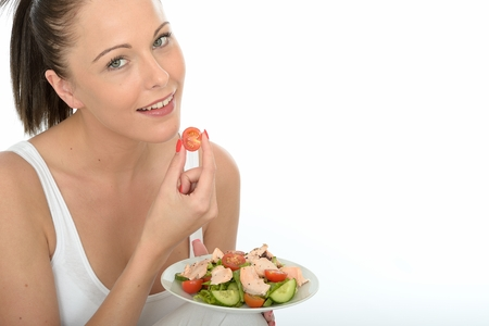 Healthy Happy Young Woman Holding a Plate of Poached Salmon and Mixed Salad