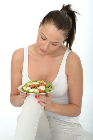 chicken salad: Healthy Young Woman Holding a Plate of Chicken Salad