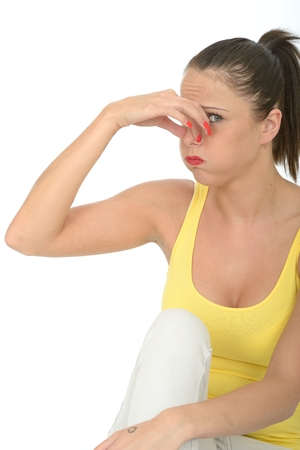 odour: Portrait of an Attractive Young Woman Holding Her Nose Avoiding Nasty Smell or Odour Stock Photo