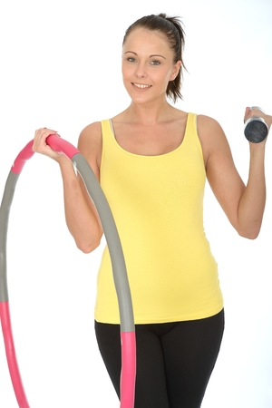 dumb: Healthy Young Woman Holding a Dumb Bell and Hula Hoop Smiling and Looking Happy Stock Photo