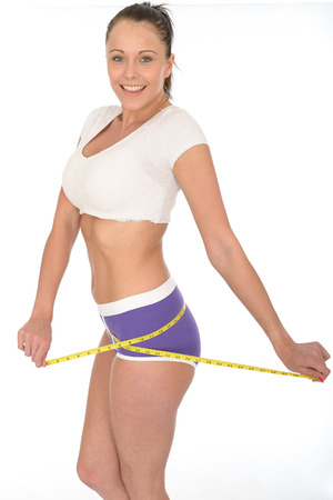 Healthy Fit Young Woman Checking Her Weight Loss With a Tape Measure Stock Photo